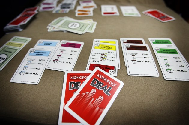Monopoly Deal does away with the game board and roll-and-move mechanic, but keeps the core components of property ownership and charging others rent.